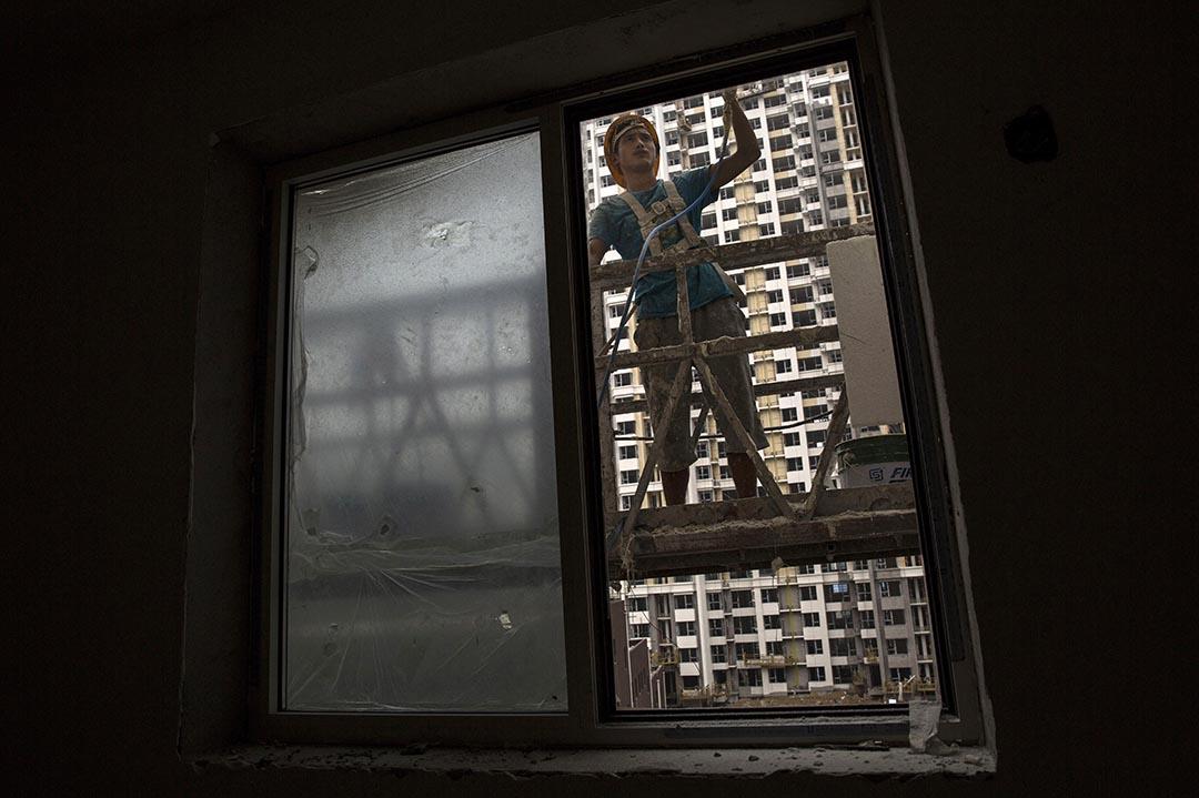 大陸官方宣布,將房地產稅法納入立法計劃。攝 : Kevin Frayer/Getty Images