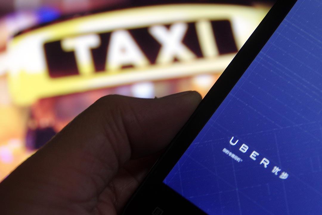 Uber(優步)的兩家最大競爭對手 Lyft 和滴滴快的達成戰略合作協議。攝:Imaginechina via AFP
