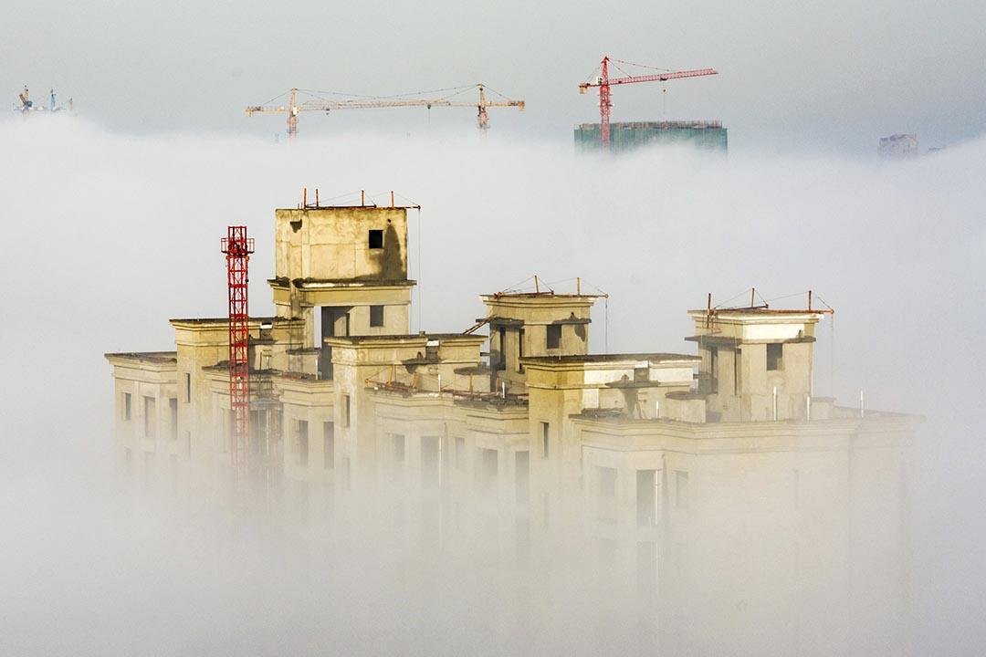 中央經濟工作會議日前在北京結束,提出化解房地產庫存等五大任務。攝 : REUTERS