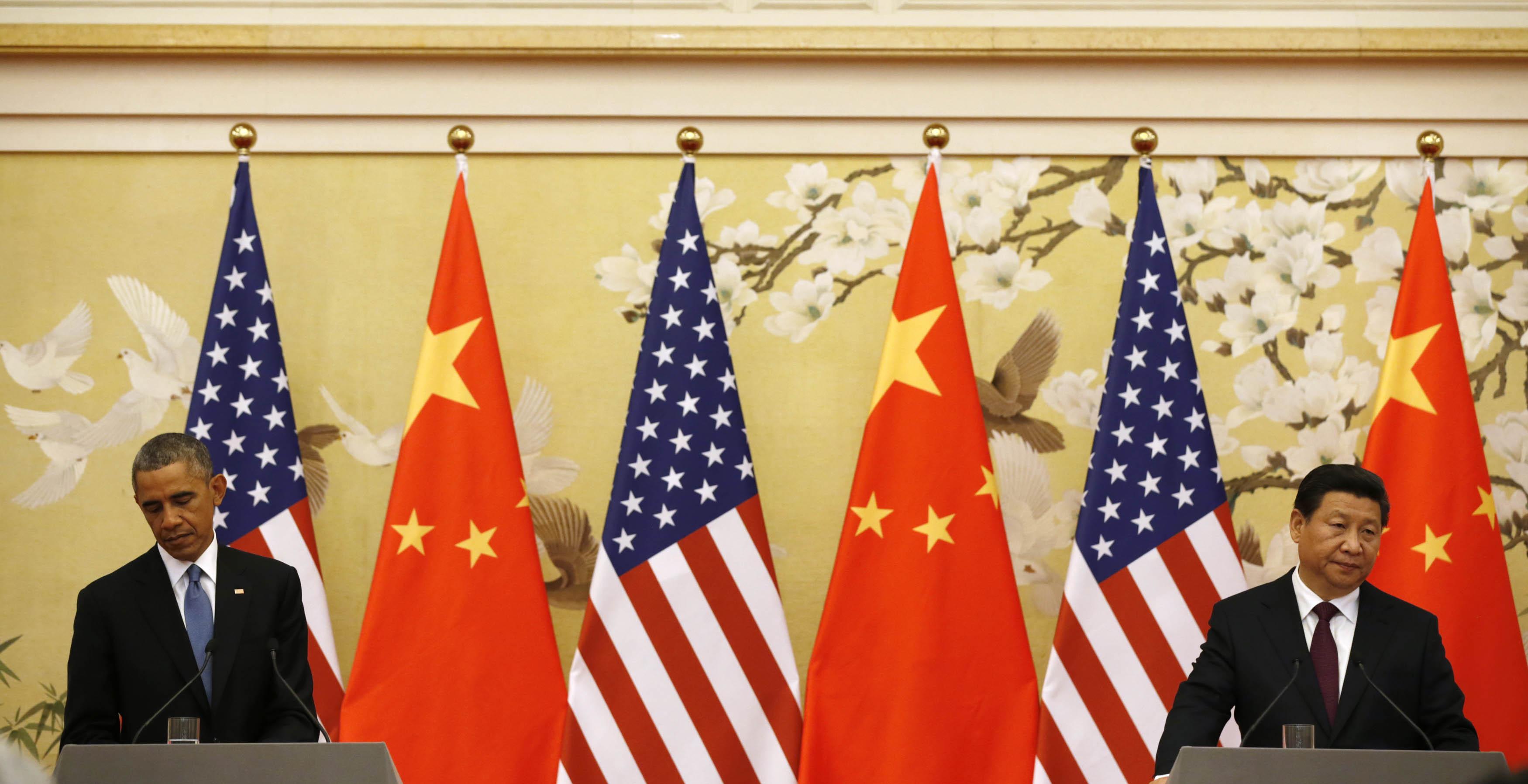 美國總統奧巴馬(左)與中國國家主席習近平(右)於北京人民大會堂召開記者會。攝:Kevin Lamarque/REUTERS