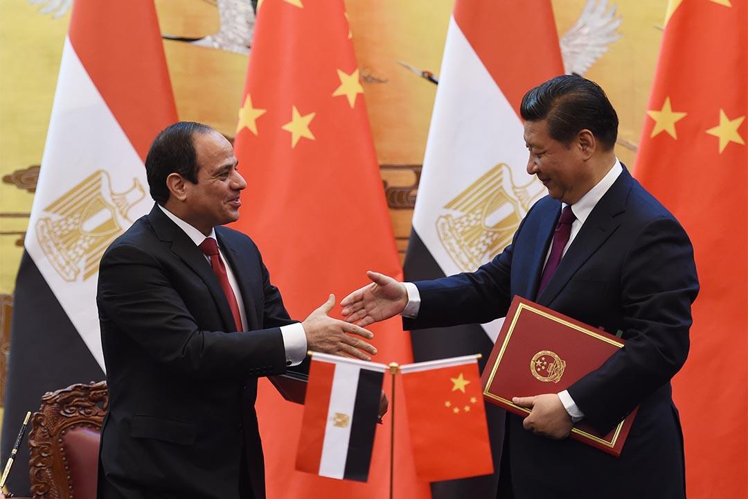 2014年12月23日,中國國家主席習近平於北京人民大會堂與埃及總統塞西進行簽字儀式。攝:Greg Baker - Pool/Getty