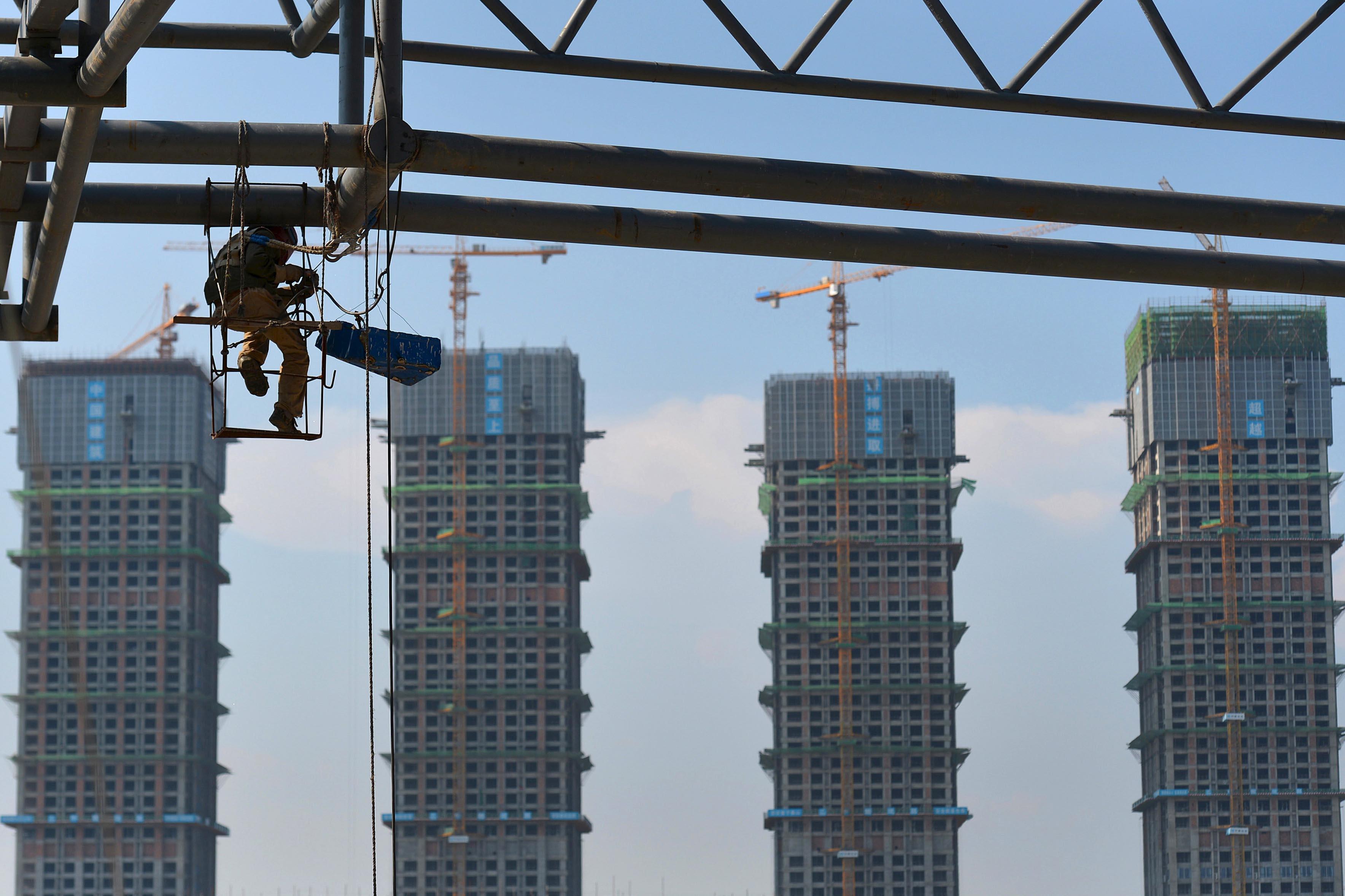 信用評級機構穆迪近日下調了2016年全球經濟成長預估,中美均遭下調。攝:Jianan Yu/Reuters