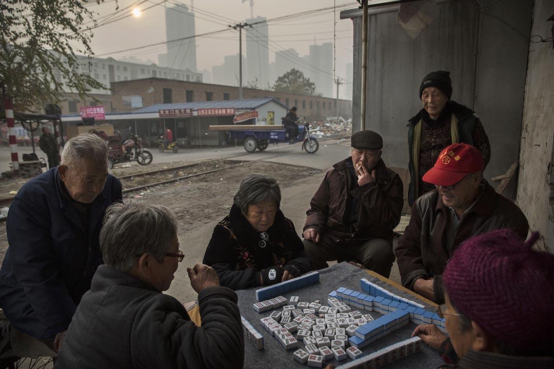 哈佛大學與北京調查機構合作的民調顯示,中國民眾對中央政府的滿意度很高,對地方政府的滿意度降至低點。攝:Kevin Frayer/GETTY