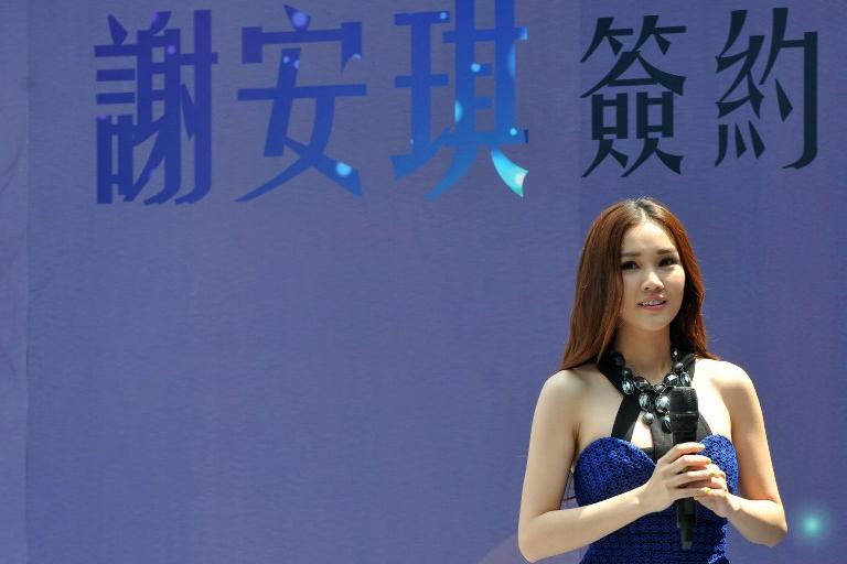 2014年5月,北京,香港歌手謝安琪出席簽約內地經理人公司的宣傳活動。攝:Tung Star