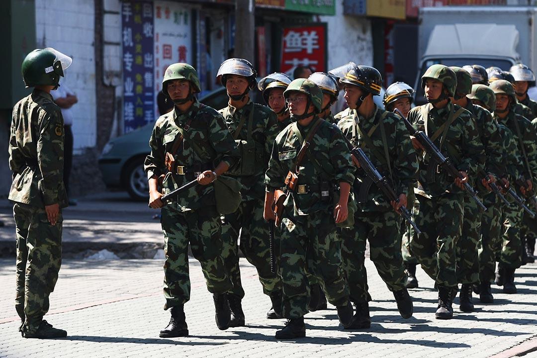2009年7月9日 警察在新疆烏魯木齊市面巡邏。攝: Guang Niu /GETTY