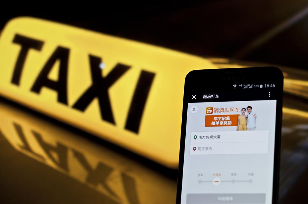 滴滴快的獲得由政府頒發的專車牌照,成為中國第一個正式持牌運營的專車平台。攝 : Imaginechina