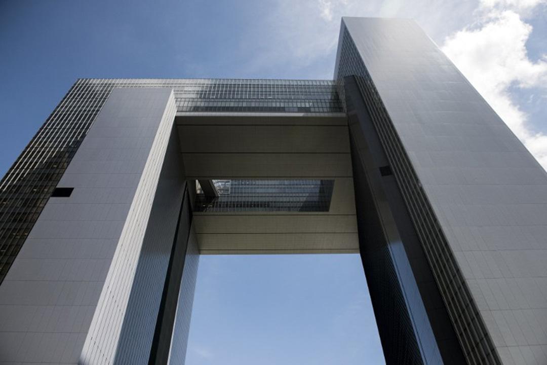 圖為香港政府總部大樓。攝:ALEX OGLE/AFP