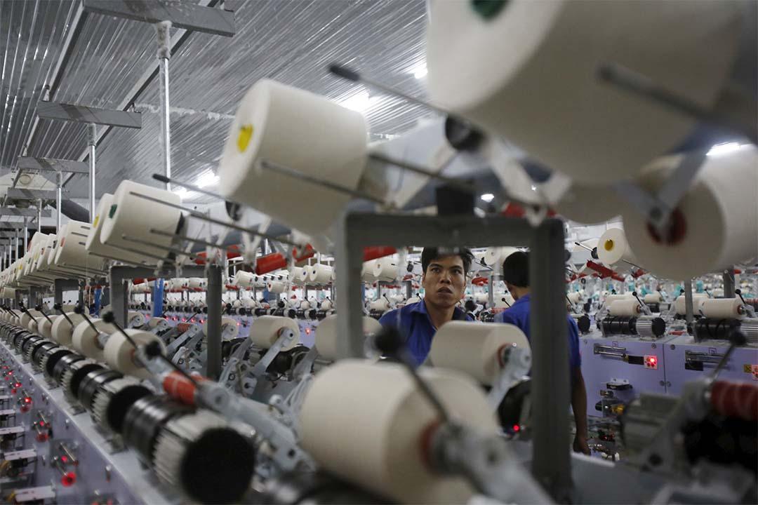 美國、日本為首的12個亞太國家的貿易談判代表達成了「跨太平洋夥伴關係協議」(TPP)。圖為工人在越南一間紡織工廠工作。攝:Kham/REUTERS