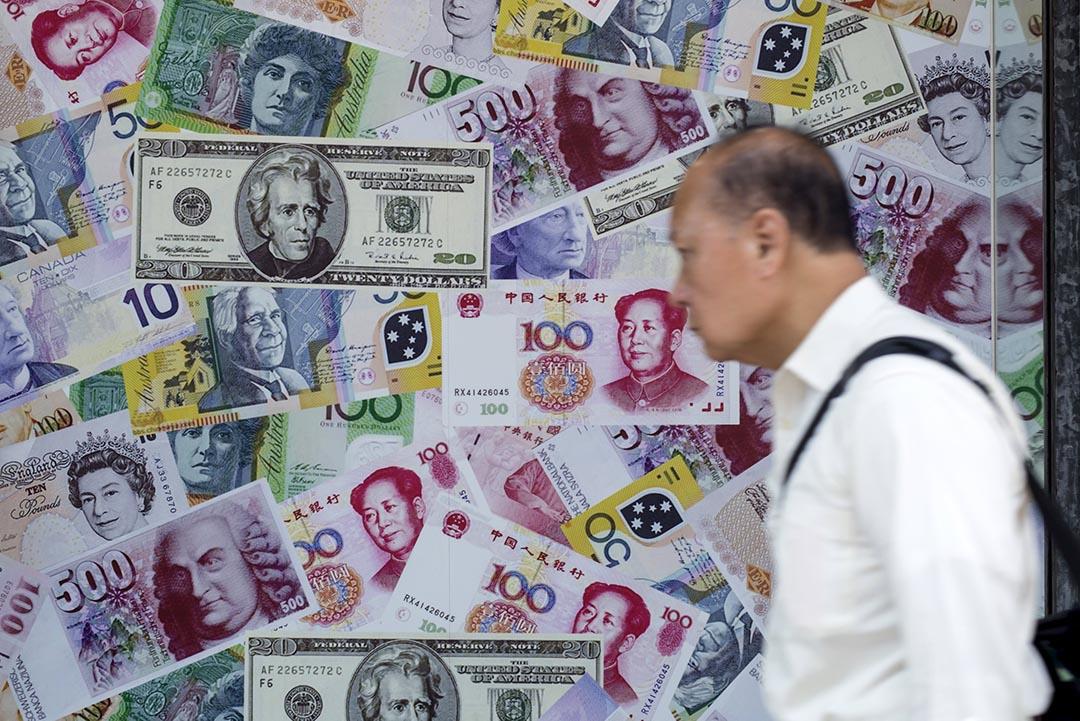 中國央行9月1日發布新規,將向代客遠期售匯的金融機構收取準備金。攝 : Tyrone Siu/REUTERS