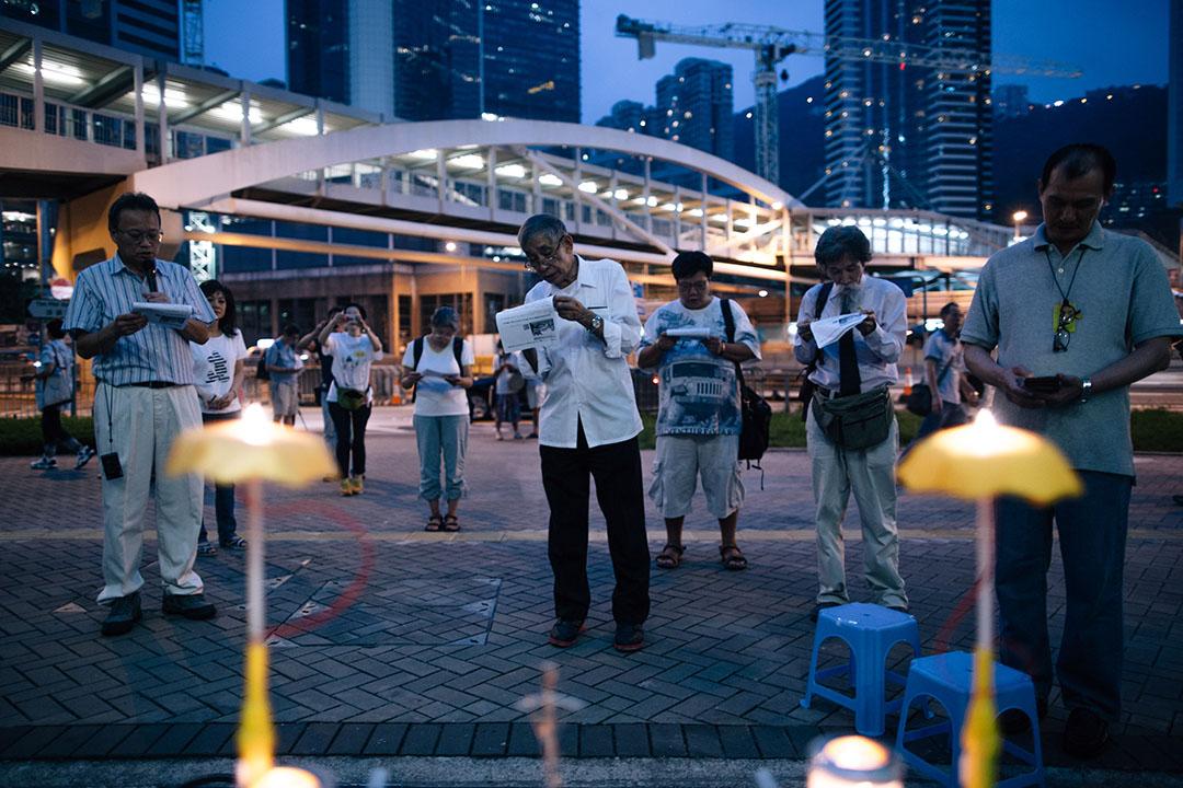 2015年9月28日,香港金鐘,爭取普選的示威者到金鐘政府總部外集會,紀念雨傘運動一周年。攝:盧翊銘/端傳媒