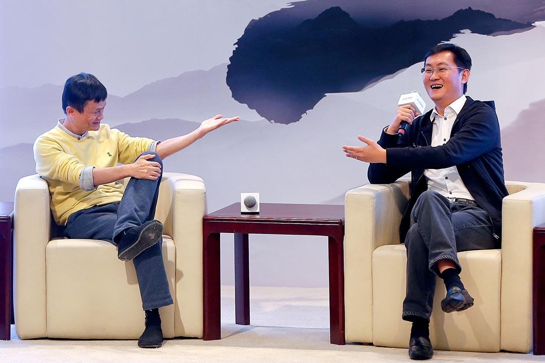 阿里巴巴和騰訊被視為此次合併的推手,圖為阿里巴巴董事局主席馬雲和騰訊CEO馬化騰。攝 : Imaginechina