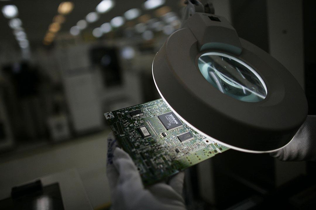 大陸清華紫光集團宣布,以近688億台幣的價格入股台灣矽品與南茂兩家大型半導體封測大廠。攝 : Dimas Ardian/GETTY