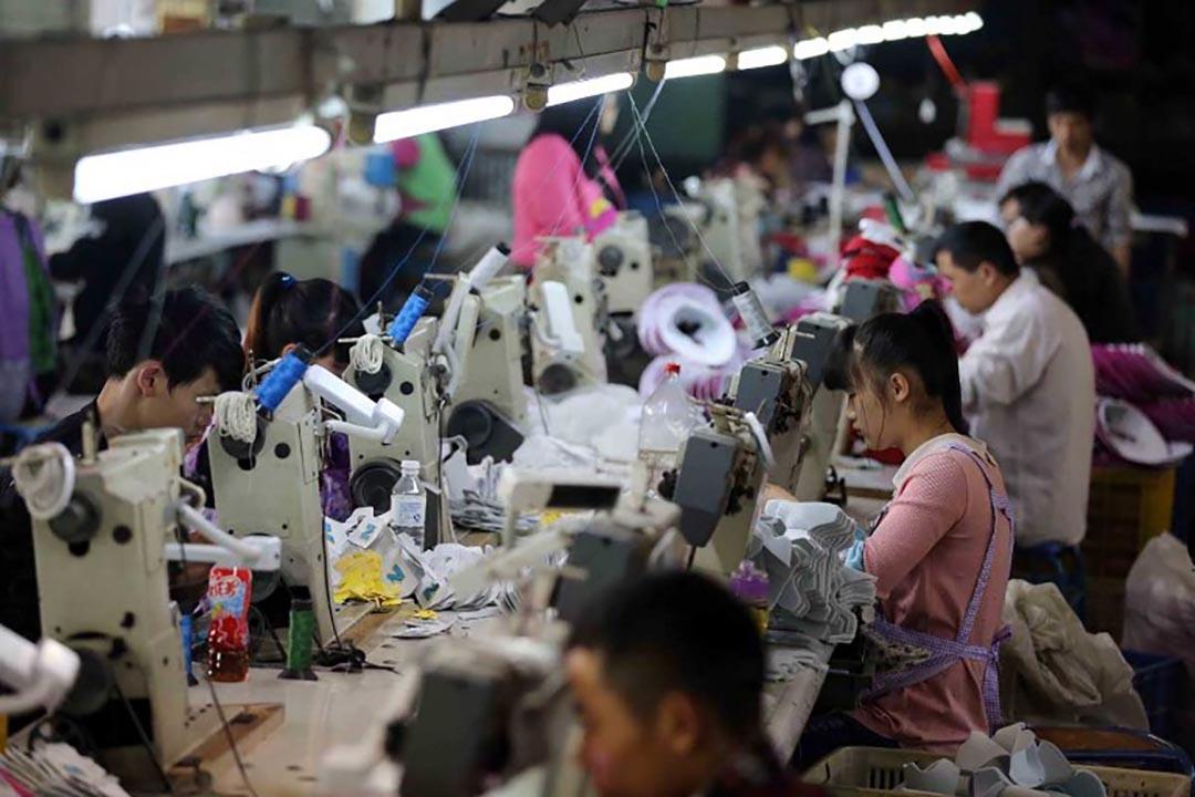 中國官方媒體新華社發布文章,指東北多地 GDP 統計數據造假。攝 : Imaginechina via AFP