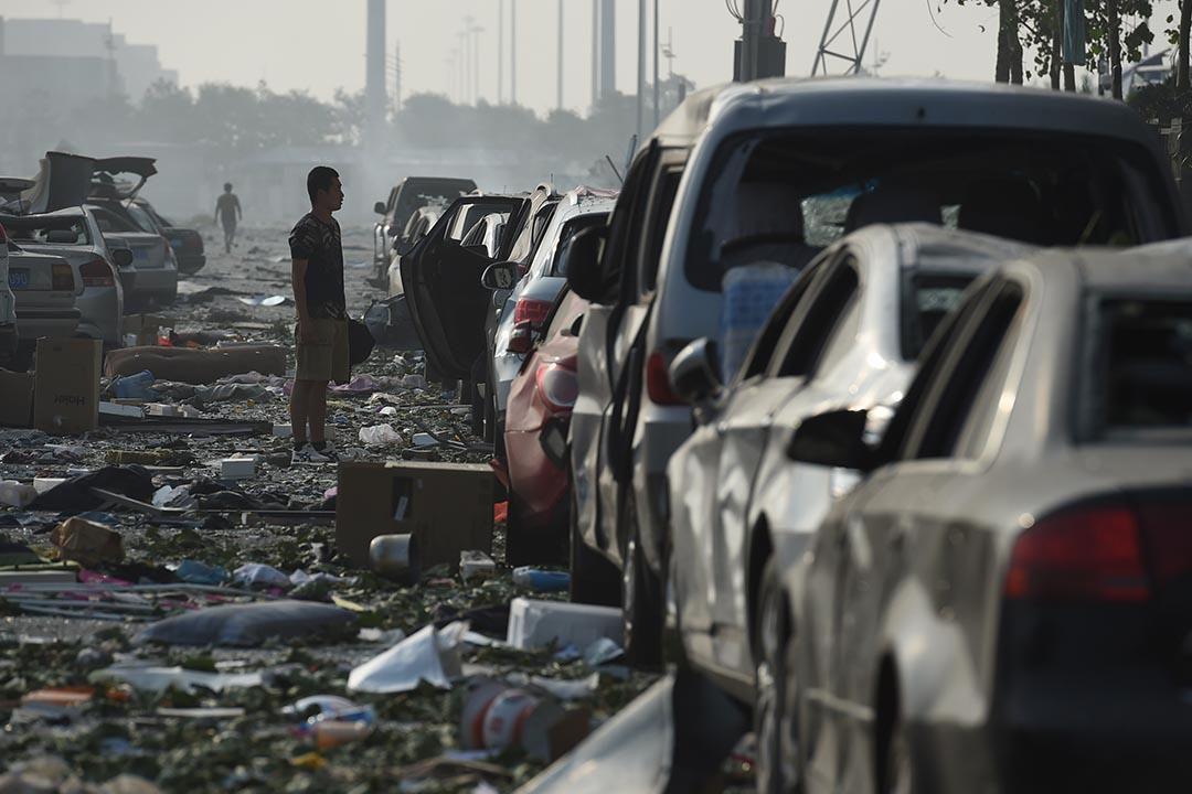 爆炸後的清晨,在爆炸現場300米外,發現多具燒焦的屍體。攝 : GREG BAKER/AFP