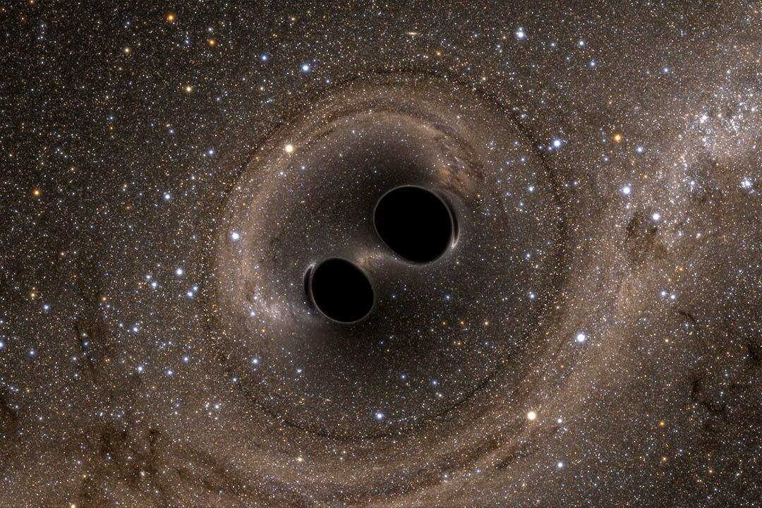 圖為電腦模擬兩個黑洞合併的影像。Caltech/MIT/LIGO Laboratory/ Reuters