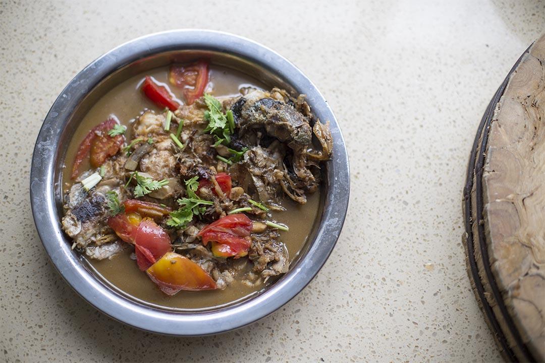 剛煮好的紅燒黃花魚,他喜歡紅燒,因為可以去腥,還多些香味!圖片由綠色和平中國提供