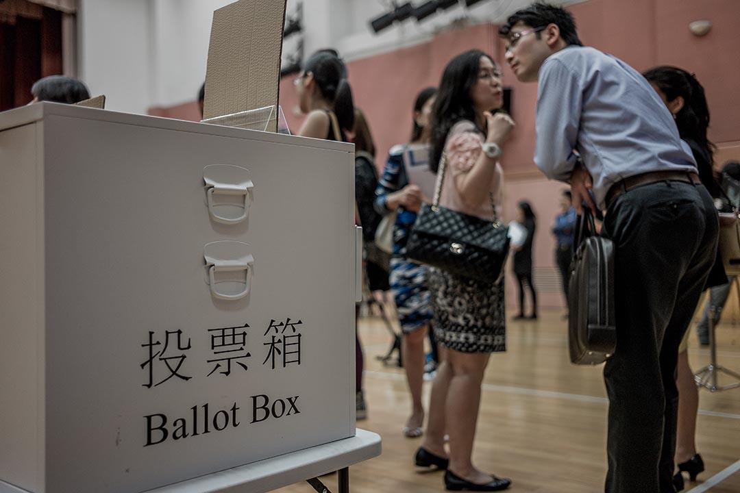 香港區議會選舉臨近,媒體曝出疑似「種票」事件。攝 : Philippe Lopez/AFP