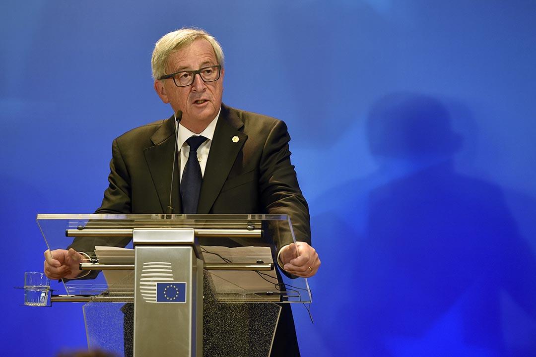 歐盟委員會主席容克在歐盟領袖峰會後向媒體談及難民危機。攝:Martin Meissner/AP Photo