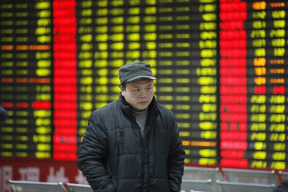2016年1月7日,圖為中國安徽省的一間證券交易所。攝:CFP/GETTY