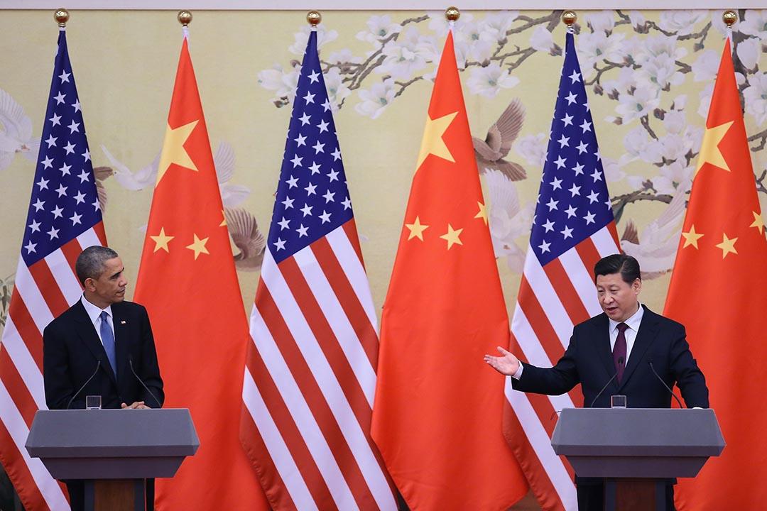 美國總統奧巴馬(左)和中國國家主席習近平(右)在北京人民大會堂出席新聞發布會。攝 : Feng Li/GETTY