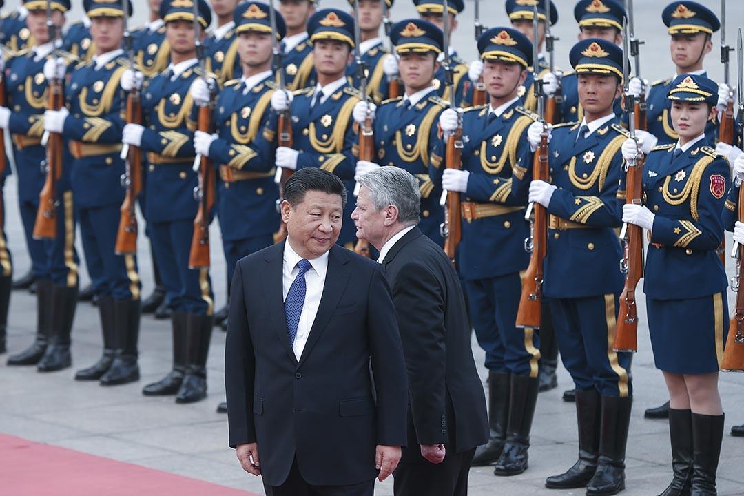 圖為2016年3月21日,中國國家主席習近平為德國總統高克舉行歡迎儀式。攝:Lintao Zhang/Getty