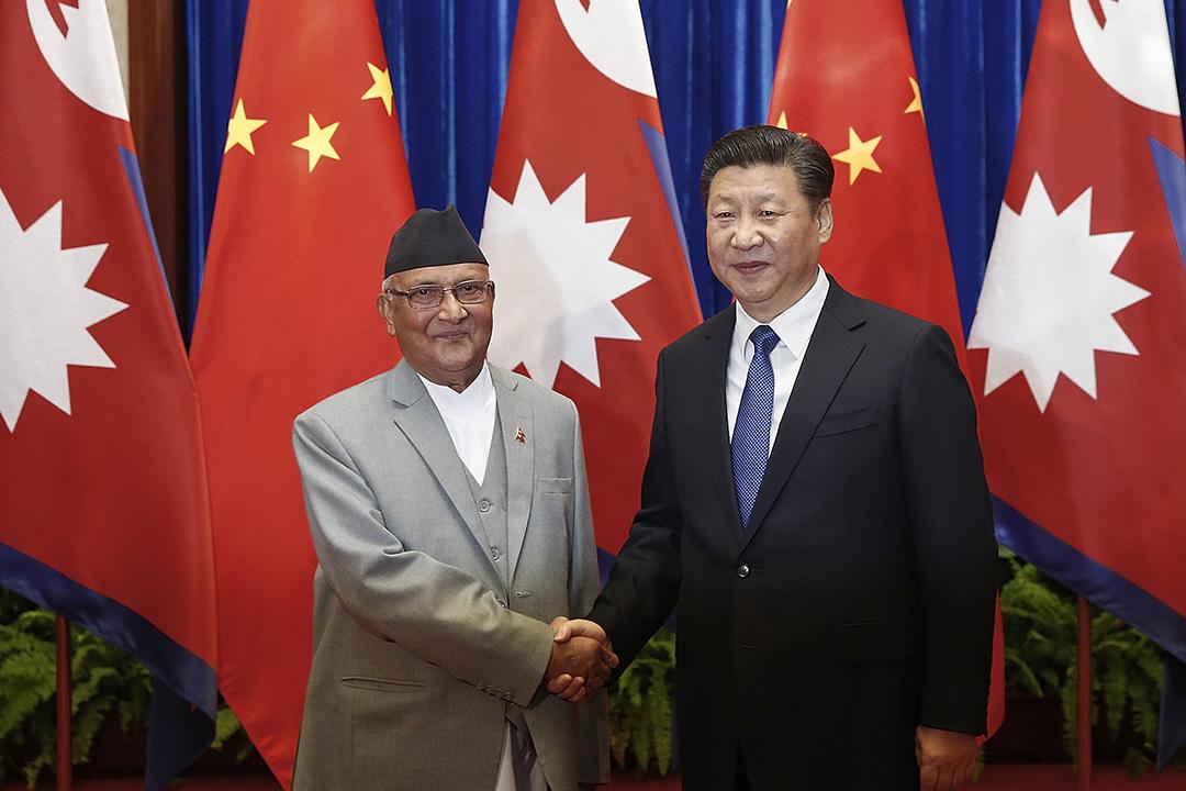 2016年3月21日,北京,尼泊爾總理奧利與中國國家主席習近平會面。攝:Lintao Zhang/REUTERS
