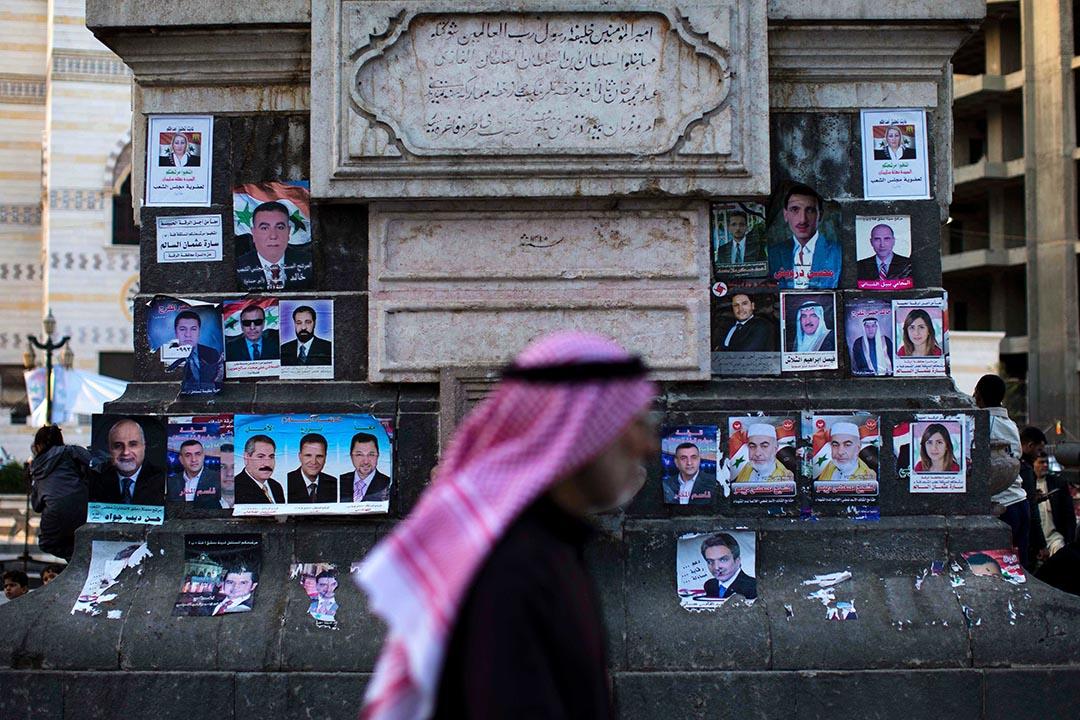 敘利亞政府不理西方國家反對,堅持於4月13日舉行國會大選。選前,敘利亞大馬士革 Marjeh 廣場上貼滿了候選人的競選海報。攝:Hassan Ammar/AP