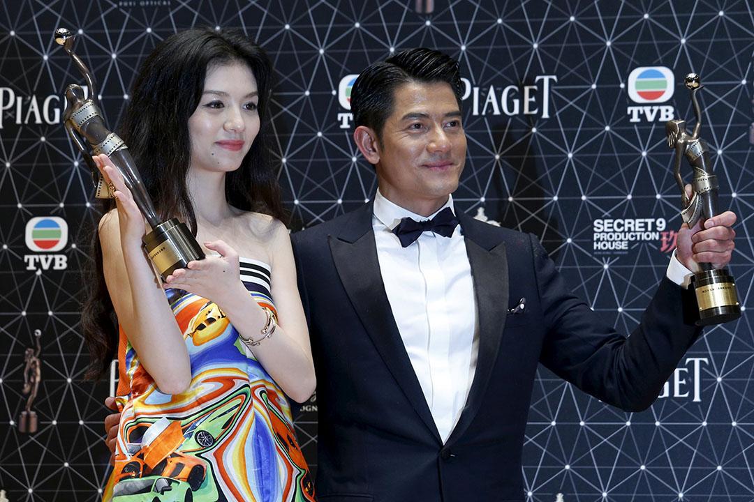 2016年4月3日,郭富城(右)及春夏(左)憑電影「踏血尋梅」奪得最佳男女主角獎。攝:Bobby Yip/REUTERS