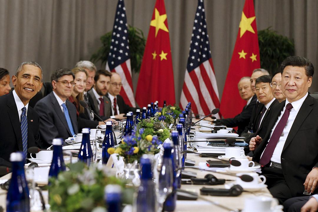 2016年3月31日,美國華盛頓,美國總統奧巴馬(左)與中國國家主席習近平(右)在核安全峰會期間會晤。攝:Kevin Lamarque/REUTERS
