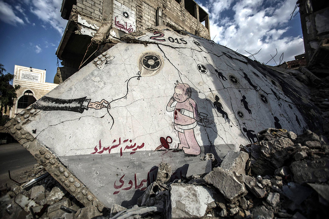 2016年8月21日,敘利亞大馬士革,牆上繪着紀念遭到化學武器襲擊死難者的塗鴉。