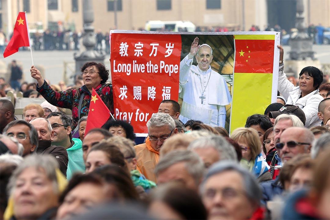 圖為2014年11月26日,梵蒂岡有中國信徒參與彌撒。