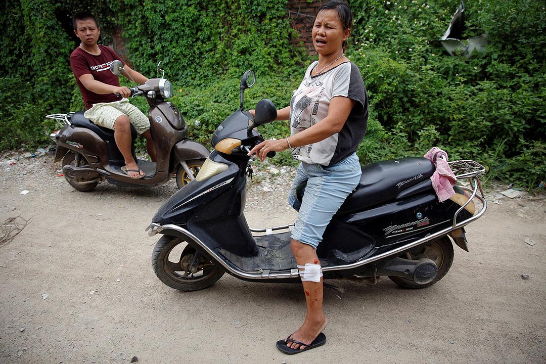 两名在冲突中受伤的乌坎村民。