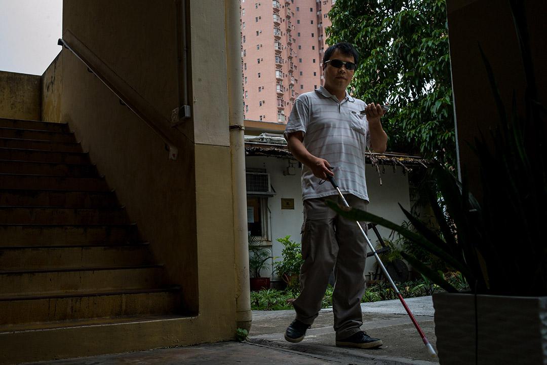 視障人士阿ming。