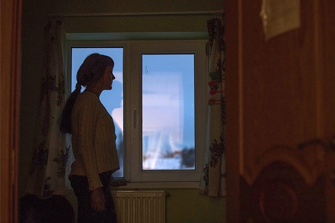 2017年1月26日,莫斯科一名被丈夫毆打的婦女在一收容所內。