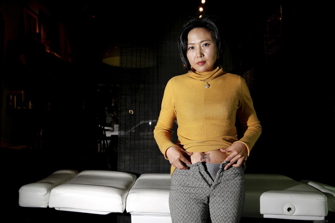 Wang Jing,46歲,育有一名20歲大的女兒。