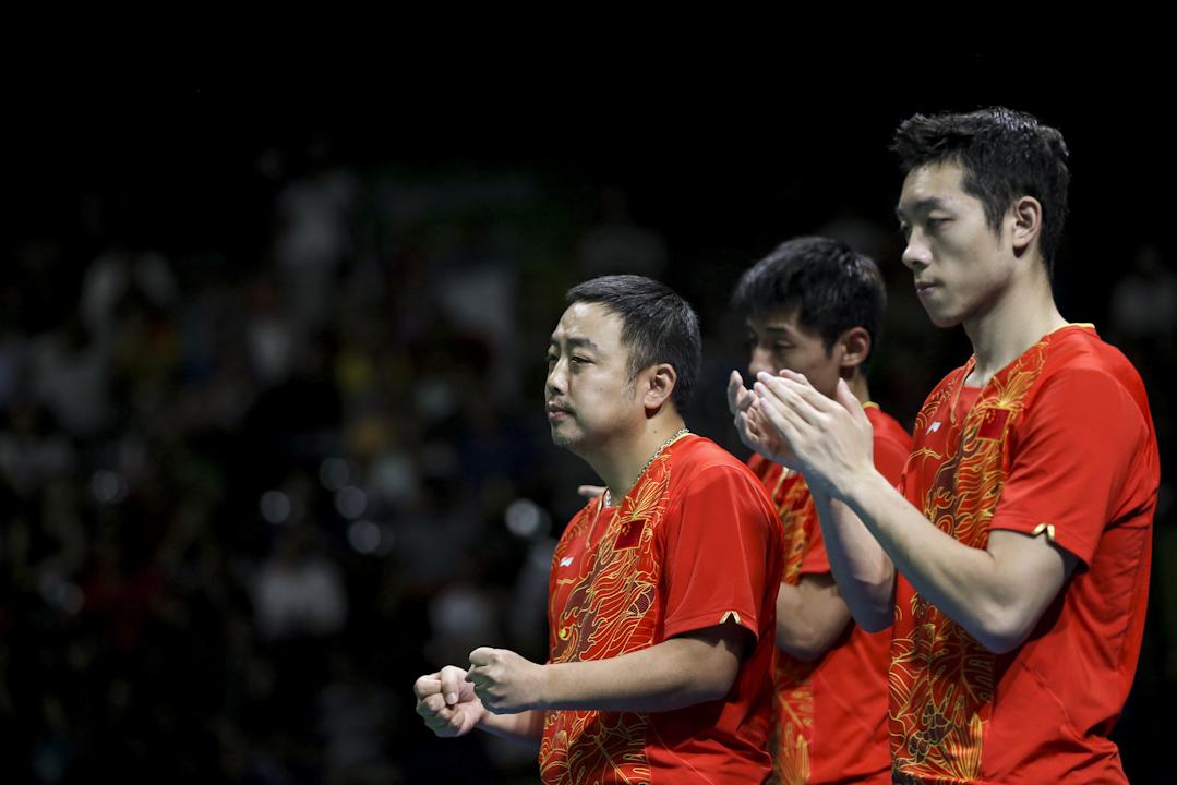 2016年8月17日,巴西裏約熱內盧奧運會乒乓球男團決賽,中國以3-1戰勝日本奪得金牌。 攝:Imagine China