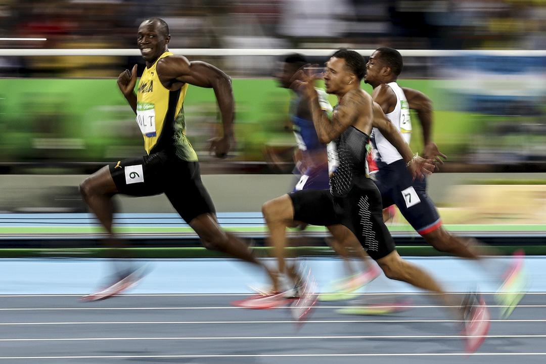 2016年8月14日,巴西里約熱內盧奧運會,男子100米準決賽,保特在賽跑中笑望著攝影區的鏡頭。