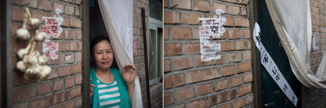 2017年6月20日,一名女子站在家門口前。