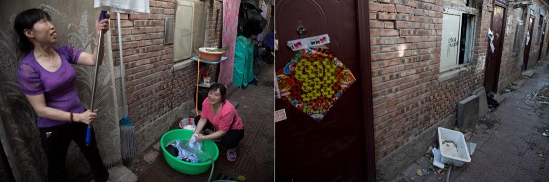 2017年6月20日,兩名女子在家門口洗衣服並把衣服掛起來晾乾。