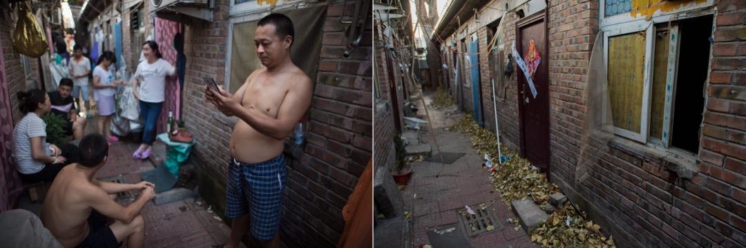 2017年8月17日,村民各自站在自己屋外的街道上打發時間。