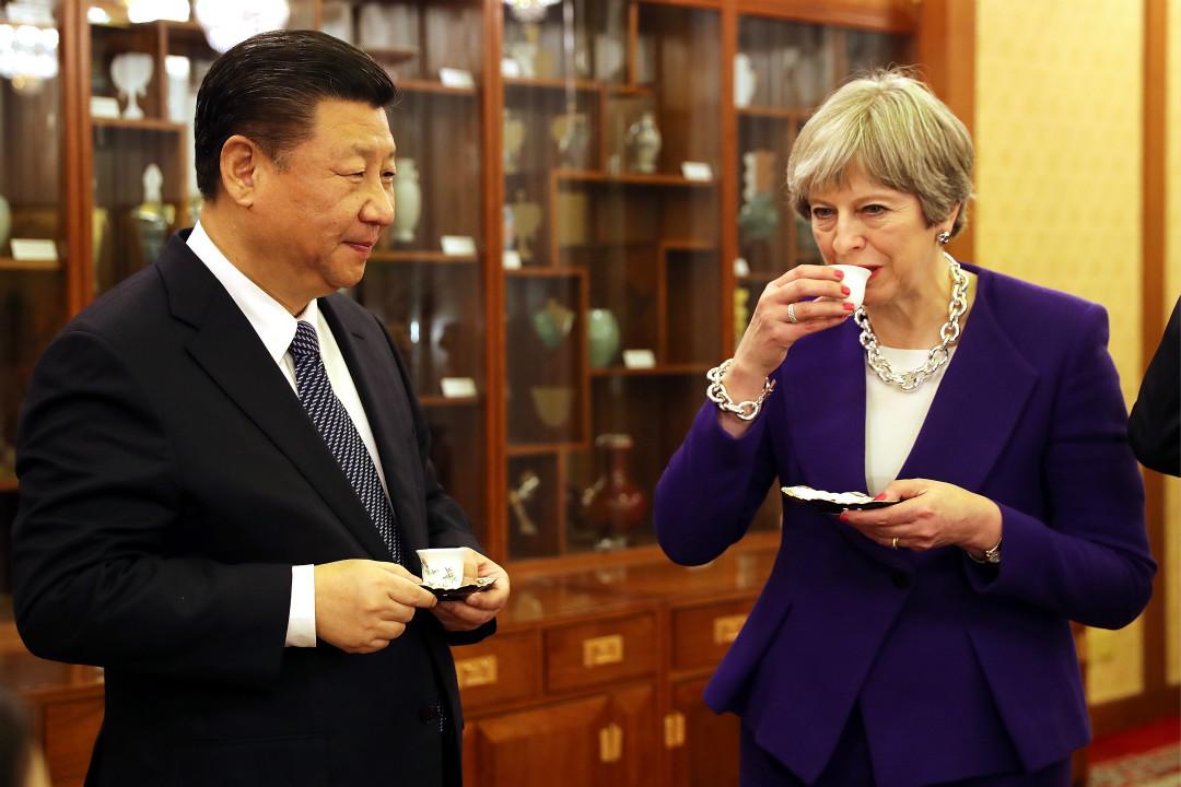2月1日,英國首相文翠珊與中國國家主席習近平在北京釣魚台國賓館品茶。 攝:Dan Kitwood/Getty Images