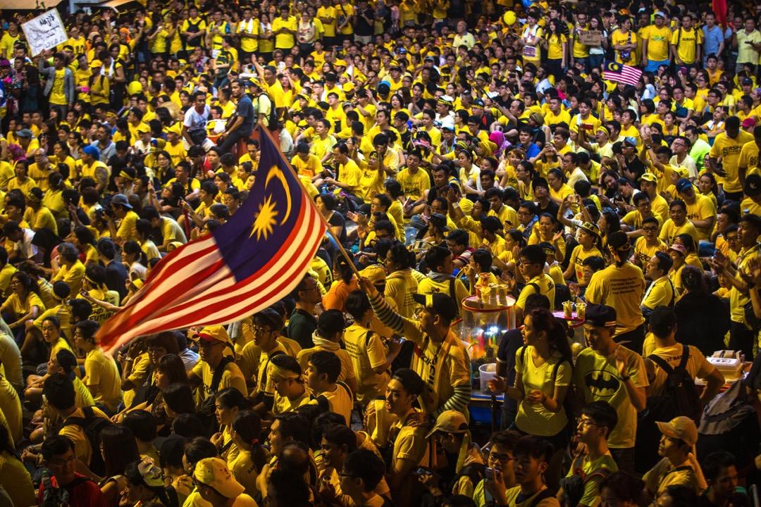 馬國非政府組織「淨選盟」(Bersih)先後在2015年和2016年發動大型遊行要求首相下台,凝聚及團結了反對派的聲音,也為GE14訂下清晰簡單「倒納」(現任首相納吉)的議程。 攝:Sanjit Das/Bloomberg via Getty Images