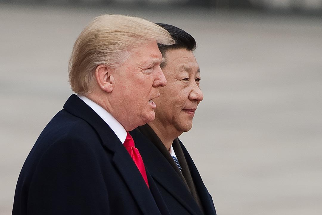 2017年11月9日,特朗普在北京人民大會堂前出席習近平為他準備的歡迎儀式。 攝:NICOLAS ASFOURI/Getty Images