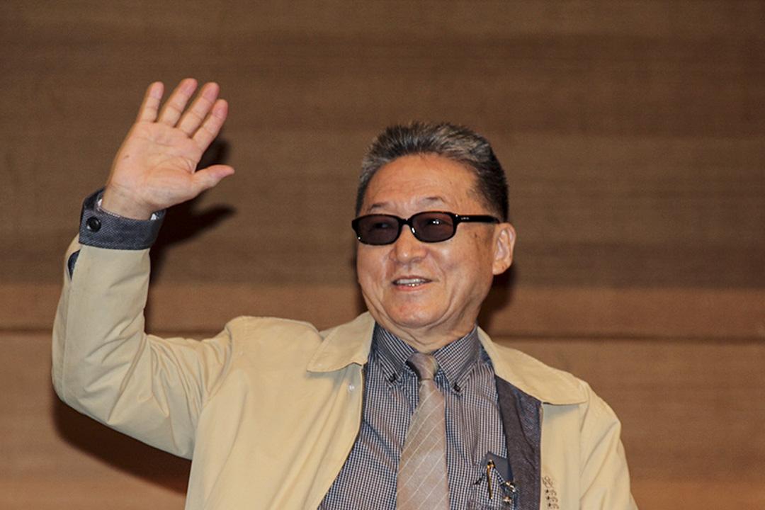 2014年7月16日,香港,已近80歲高齡的台灣作家李敖和他的兒子李戡,在第25屆(2014年)香港書展首日出席「名作家講座係列」活動。 攝:Imagine China
