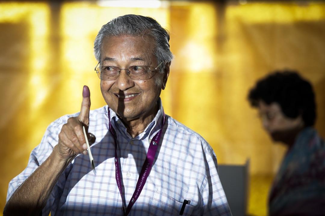 馬哈迪的加盟確實增加了變天的機率,但也冒着重回一人獨裁的風險。 攝:Andy Wong/AP