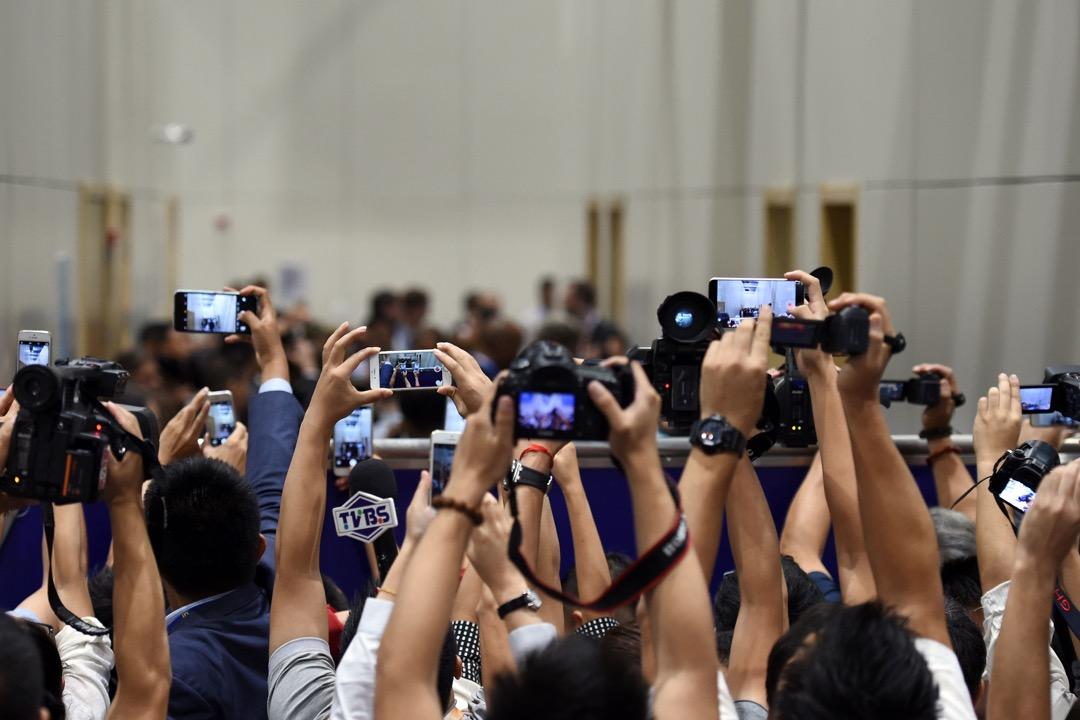 「跟沒有新聞自由的國家,談什麼新聞自由協議!」這個問句問得太膝反射。 攝:Stephane de Sakutin/AFP/Getty Images