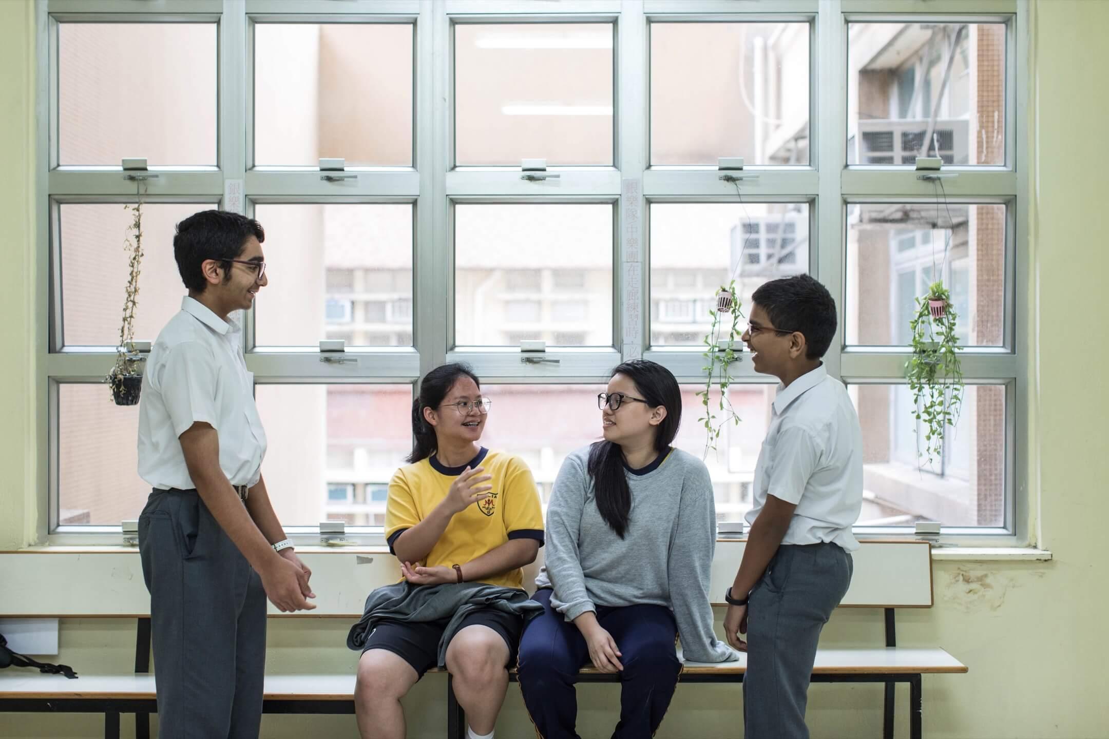 地利亞修女紀念中學(吉利徑)因其辦學機構一直有招收基層少數族裔學生的傳統,故2010年起開始招非華語學生,現在少數族裔學生是學校的大多數。由於學生背景多元,故現時授課語言為英文。 攝:Stanley Leung/端傳媒