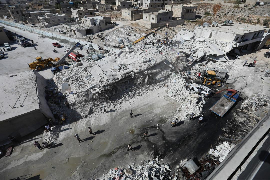 2018年8月12日,敘利亞城鎮薩瑪達(Sarmada)一處反抗軍武器庫發生爆炸,造成至少39名平民喪生,其中包含12名兒童。 攝:Lomar Haj Kadour/Getty Images