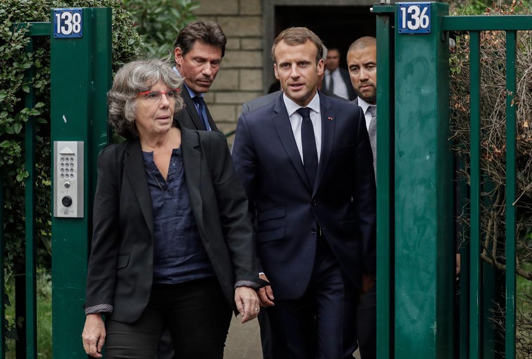 2018年9月13日,法國總統馬克龍連同奧丹的女兒米謝勒一同步出奧丹的遺孀舒錫的家。