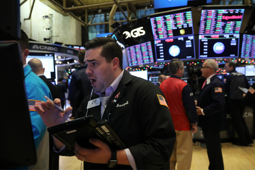 2018年12月4日,紐約證券交易所, 投資者擔心中美潛在貿易戰可能性增加,道瓊斯工業平均指數下跌近800點。 攝:Spencer Platt/Getty Images